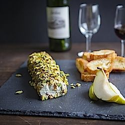 Homemade cheese log, made with blue cheese, rye, sage and pistachios.