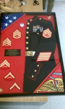 Would be a nice idea years down the road! This is a great way to display old uniforms for service members.