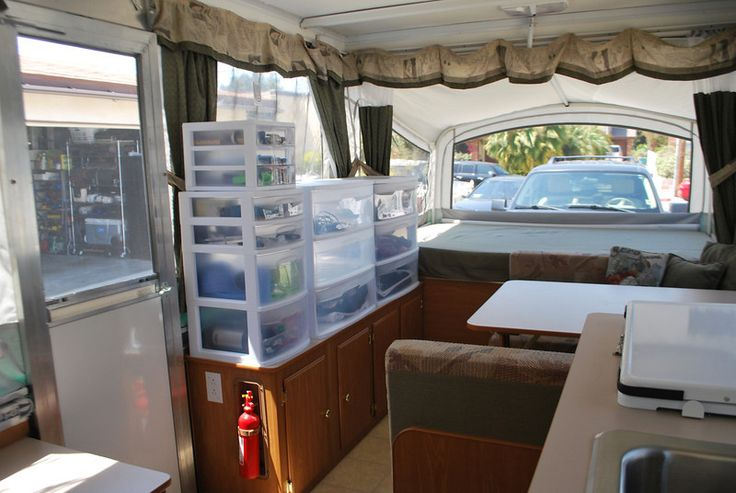 Pop up camper storage/organization: plastic bins (keep in mind roof height so bins can be transported in the pop up)