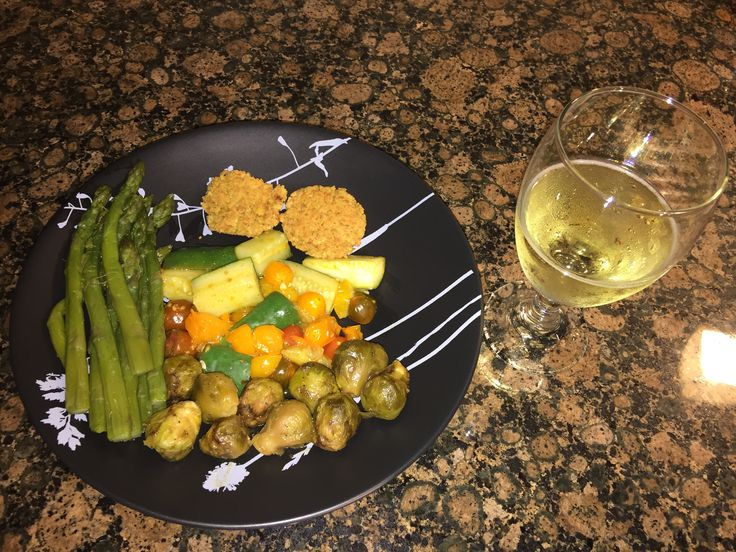 New Years Eve Dinner with asparagus, Brussels sprouts, cooked cucumber and baby tomatoes with chickpea bites ( blend the chickpeas till soft but still have chunks in it and bake in oven on 400 degrees filling oven every 5 min till brown. And sparkling grape juice. #vegan