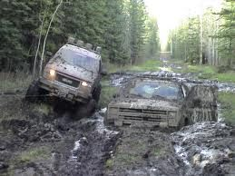 That's what I call muddin, except for that one truck looks like he's getting stuck more than muddin lol