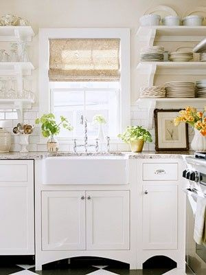 Open shelving an apron front sink subway tile back splash and black and white flooring.... pretty much my dream kitchen essentials