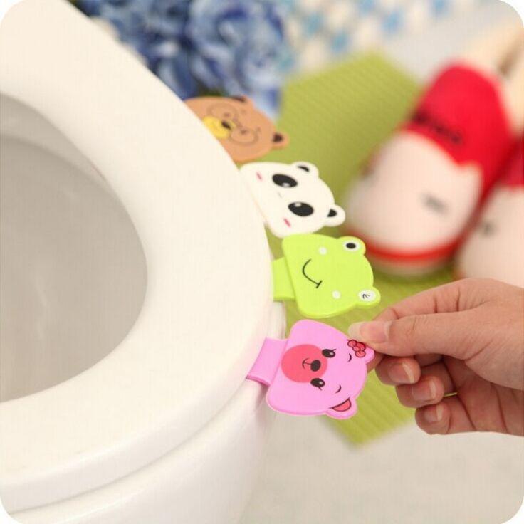 Gratis pengiriman 1 pcs portabel nyaman untuk tutup Toilet perangkat adalah menyebutkan Toilet set potty cincin menangani rumah Kamar Mandi produk set