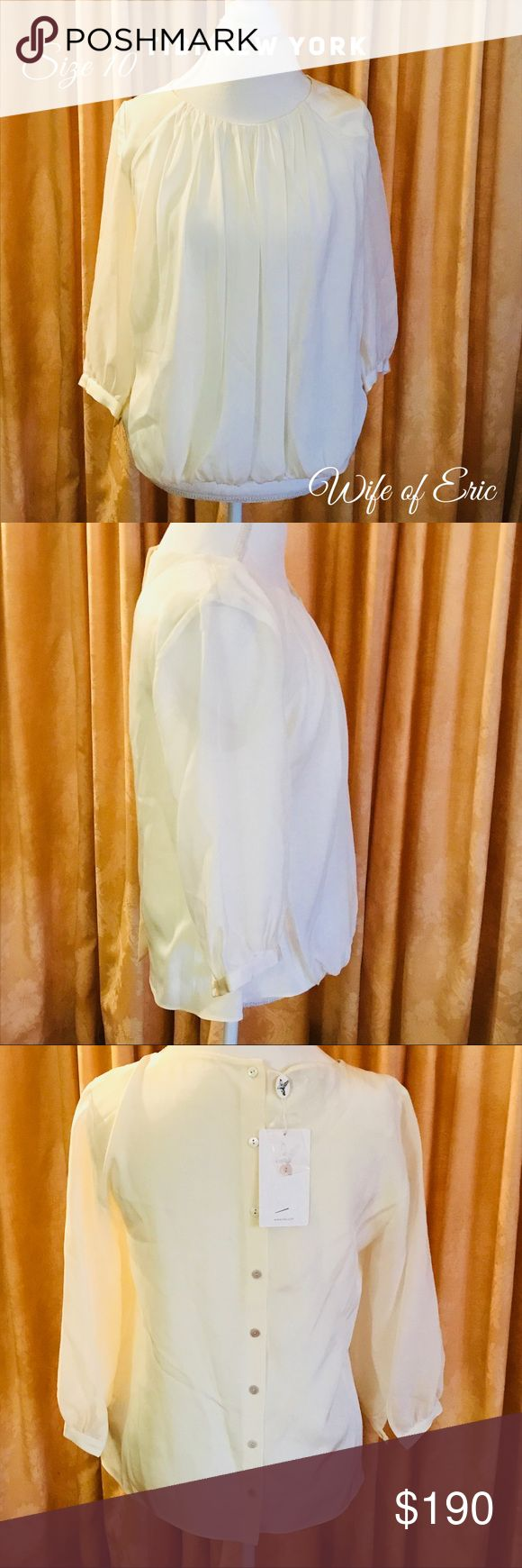 """TIbi New York Silk Pleated Blouse Button Back Stunningly beautiful ivory silk blouse. Features a Pleated front and buttons down the back.  It is slightly sheer on the 3/4 length sleeves. Purchased with the TIBI skirt they are a perfect match. Approximate measurements  Bust 38 Length 26"""" Tibi Tops Blouses"""