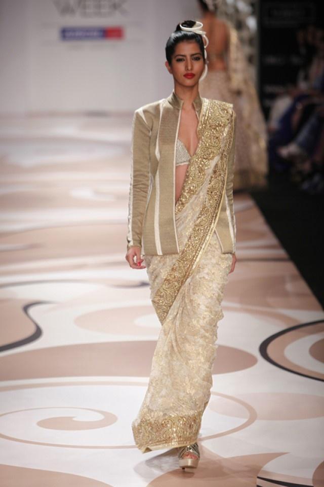 #9 - dramatic white and gold Vikram Phadnis sari with bikini top and a tailored sari jacket