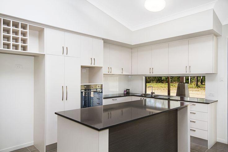 Kitchen www.martinlockehomes.com.au #kitchen #tiling #winerack #pantry #stonetop
