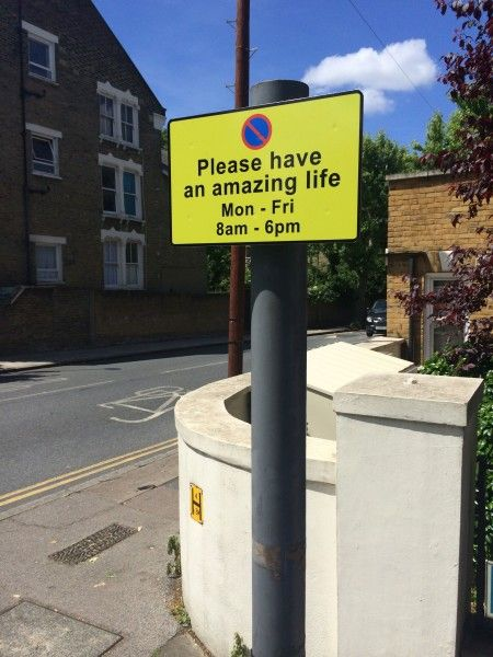 an improved parking restriction sign