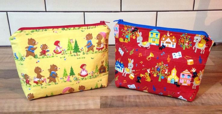 Make up bags Cosmo Textile Japanese cotton fairy tale prints.   https://www.facebook.com/GirlsGotFabric https://www.etsy.com/uk/shop/GirlsGotFabric