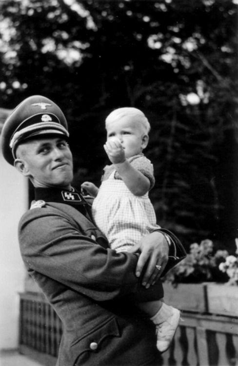 1941 - SS-Obersturmführer Hans-Jörg Hartmann photographed with his daughter.