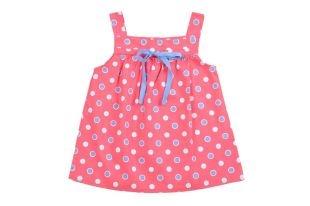 Blusa para niña en color coral estampada con lunares blancos y azules. Escote cuadrado y sin mangas.