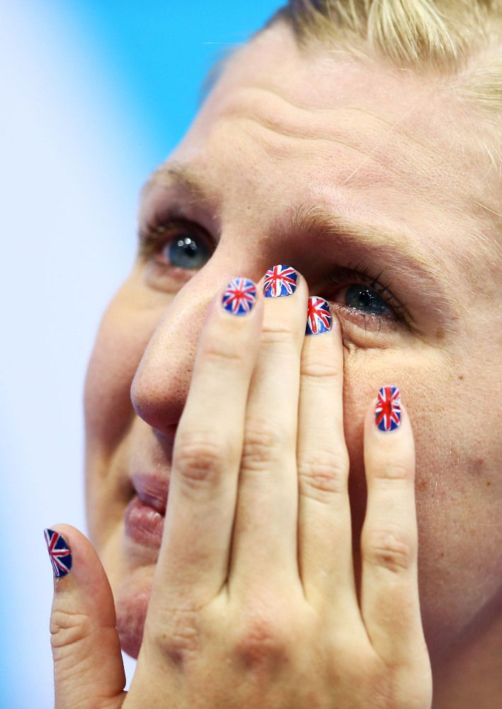 Bronze medallist Rebecca Adlington shows her emotion on the podium