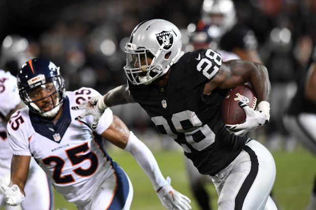 Broncos vs. Raiders:   November 6, 2016  -  30-20, Raiders  -    Oakland Raiders running back Latavius Murray (28) rushes past Denver Broncos cornerback Chris Harris (25) to pick up few yards during the fourth quarter of an NFL game at Oakland-Alameda County Coliseum on Nov. 6, 2016, in Oakland, Calif.