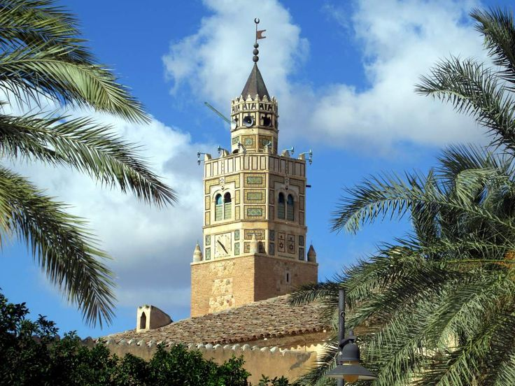 An ornate minaret watches over the 17th century Grande Mosquée in Testour, Tunisia.