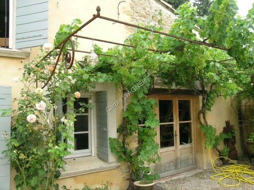Iron not wood! Use wrought iron accents instead of wood for trellising, pergolas, shade over windows/doors, etc...