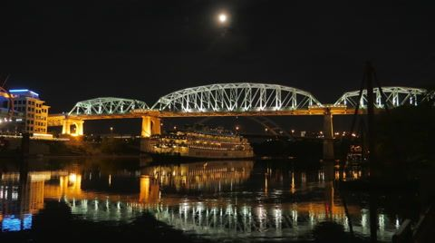 Stock video footage A moonlit night with the General Jackson on the Cumberland River in downtown Nashville under a full moon below the Shelby Street Bridge with the beautiful lights of the bridge ...