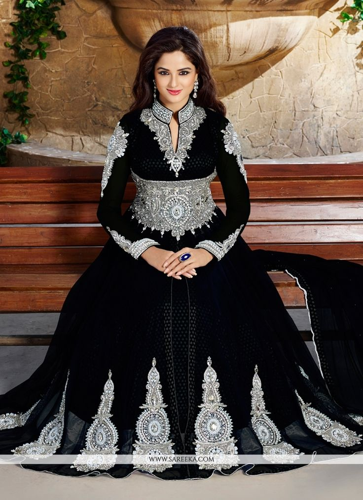 Look ethnic in this sort of a affluent black net anarkali salwar kameez. The wonderful embroidered and stone work a significant attribute of this dress. Comes with matching bottom and dupatta. (Slight...