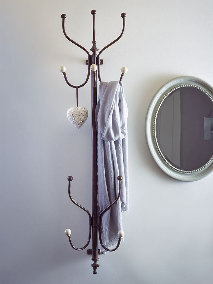Easy to secure to the wall, this slim, elegant coat stand features ten vintage…