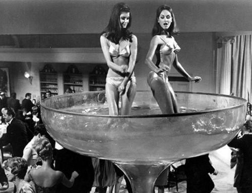 Women bathing in giant champagne glass