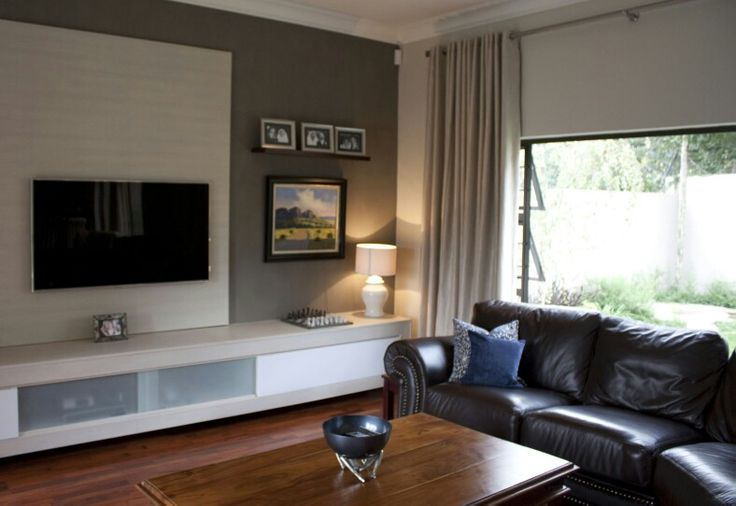A Backing Board Gives Some Style To A Wall Mounted Tv