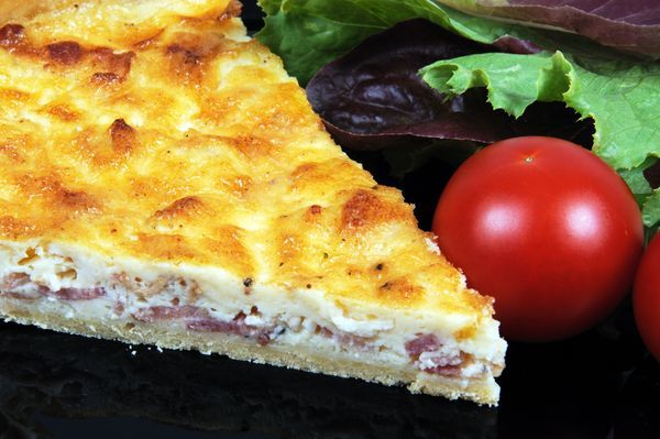 QUICHE LORRAINE  1 frozen pie crust  8 slices bacon cut into 1/2″ pieces and cooked 2 large eggs 2 large egg yolks 1 cup whole milk 1 cup heavy cream 1/2 teaspoon salt 1/2 teaspoon white pepper a pinch of nutmeg 1/2 cup gruyere cheese
