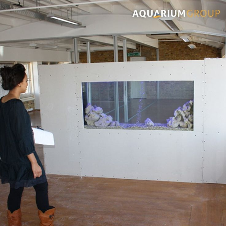 Office space room divider fish tank under construction for Construction aquarium