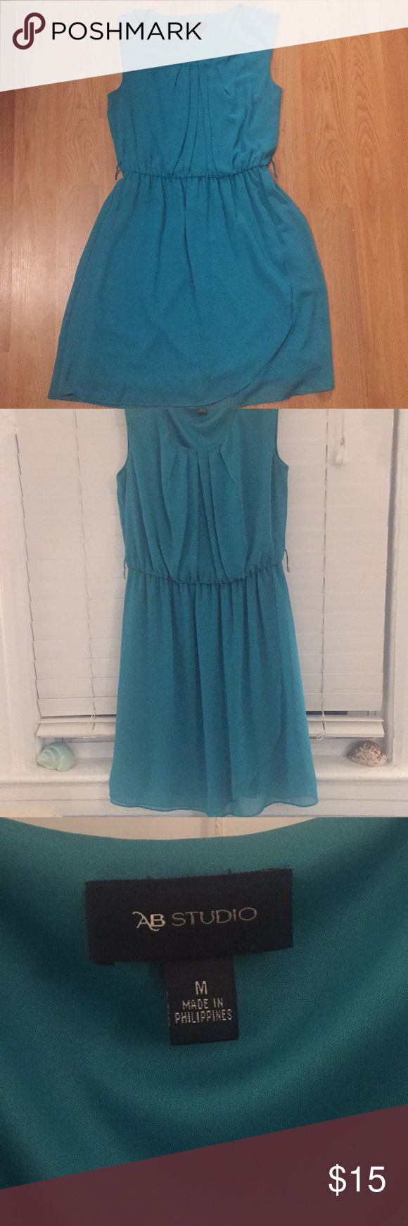 Spring and summer dress This light weight turquoise dress is perfect for summer bbqs or spring days. This dress looks great with a cute belt and boat shoes or sandals. Quick to put together and adorable. Dresses Midi