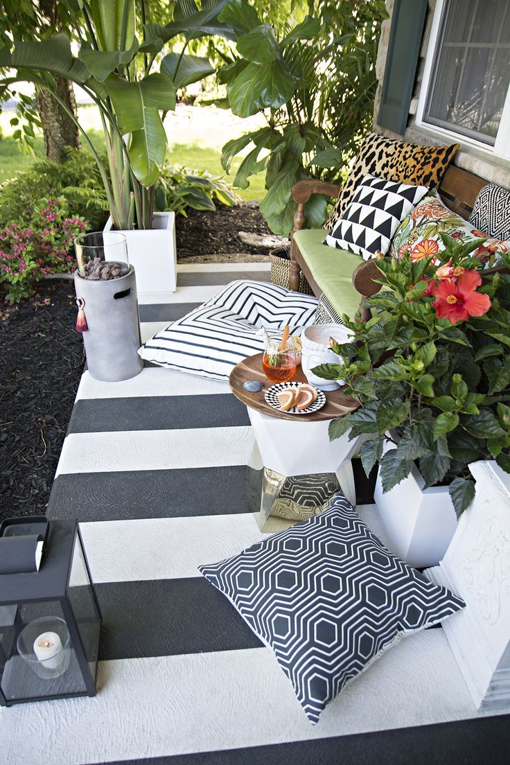 Outdoor living ideas by quiet earth landscapes - Black And White Striped Porch With Tropical Plants And Lots Of Pillows