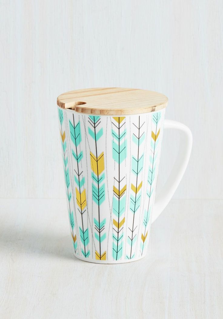 Take a chance on this ceramic mug! It's a little taller than your average coffee vessel, touts a cute-as-can-be arrow print colored in black, sky blue, and metallic gold, and is topped with a wooden tea steeper. Not your average mug - but that's why you'll love it so much!