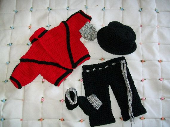 Cuz this is Thriller, Thriller time. How hip, fun, and adorable is this little ensemble. I remember when I was first thinking of this little outfit, I wasn't quite sure. But I am so happy that I kept up with it, because the outcome was great. This is truly a wonderful costume for baby pictures. Outfit is made with quality yarn. Entire outfit comes with everything as seen in the picture.  Sizes: Newborn 0-3 Months