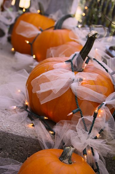 Autumn wedding decorations.   Paint the pumpkins with the wedding colors and add Halloween colored lights and black lace.