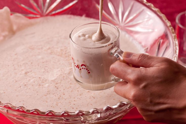 Try out this traditional eggnog recipe made with real eggs, milk, cream, bourbon, rum, brandy, and nutmeg.