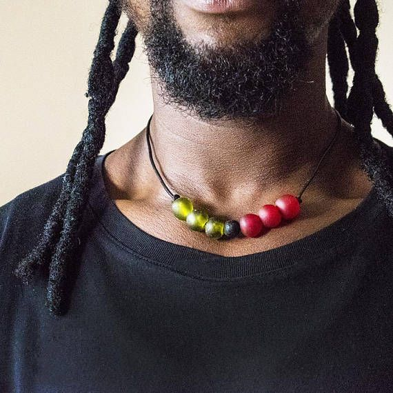 Beaded leather necklace featuring African beads in the colours of Kwanzaa by Challey Ayekoo * This listing is for a single necklace * The necklace is roughly 17 inches long and has an extendable chain should you need it. * The beads are handmade in Ghana from recycled glass bottles.