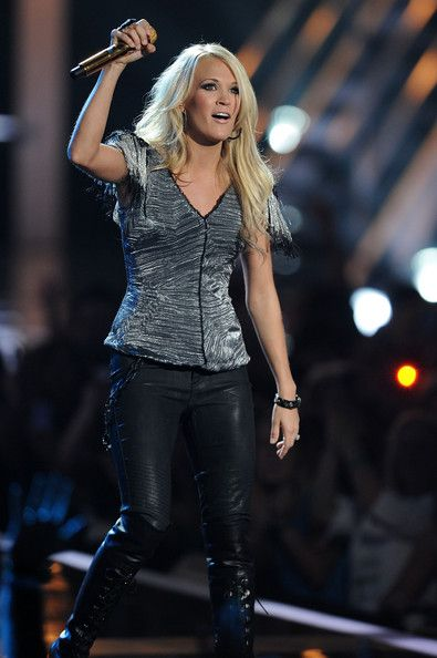 Carrie Underwood Photos Photos - Carrie Underwood performs onstage at the 2010 CMT Music Awards at the Bridgestone Arena on June 9, 2010 in Nashville, Tennessee. - 2010 CMT Music Awards - Show