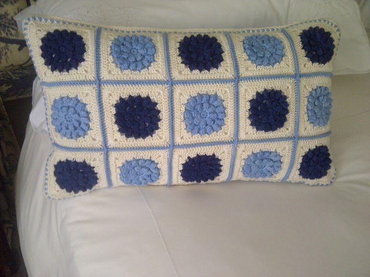crocheted cushion
