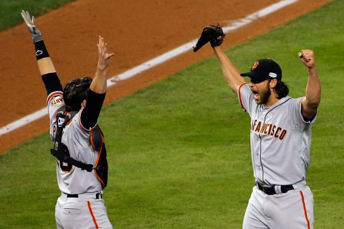 Buster Posey and Madison Bumgarner  celebrate after winning the 2014 World Series. Click through for Roger Angell's article on the series.