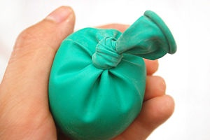 Home made stress balls.  Just fill a balloon with sand or flour and tie it off.  Easy to make, and small kids will have a blast squeezing it and shaping it.