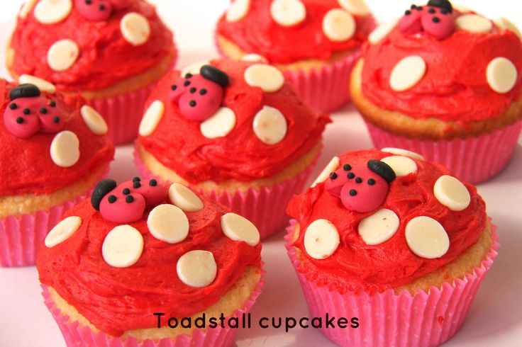Oh-so-cute Toadstool cupcakes. Red buttercream icing with inverted white chocolate chips. And yum! Visit www.notanotherslipperydip.com