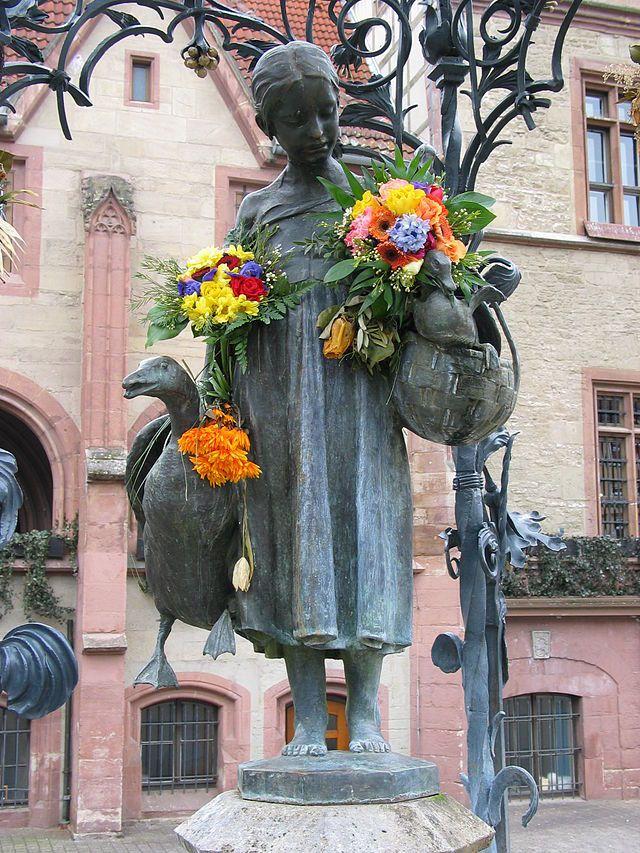 Landmark Gänseliesel fountain at the main marketplace in Goettingen, Germany.