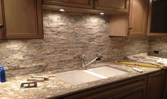 Stacked stone backsplash kitchen pinterest stone for Outdoor kitchen backsplash ideas
