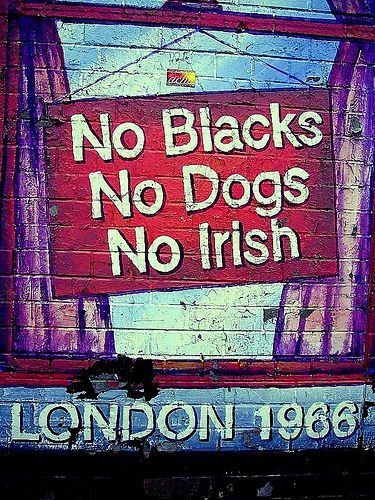 """1966 Racism in Britain - Prior to the Race Relations Act 1965, the discrimination against the minority communities was widespread Signs were often displayed at prominent places stating """"No Blacks, No Dogs and No Irish""""."""