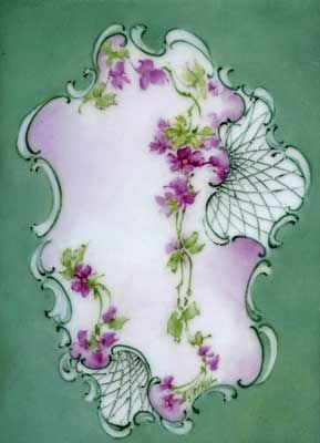 Violets and scrolling painted on porcelain tile by porcelain artist and teacher, Gerry Burchill of New York's Adirondack region