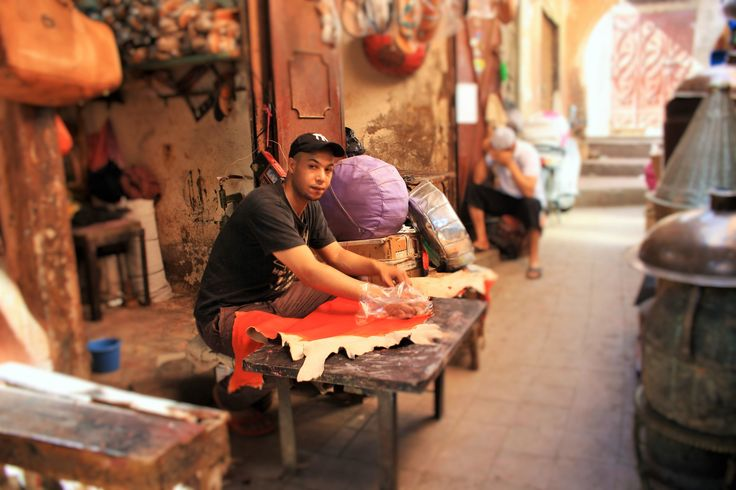An artisan in a Marrakech workshop naturally colouring leather. #moroccanorange #orange #tan