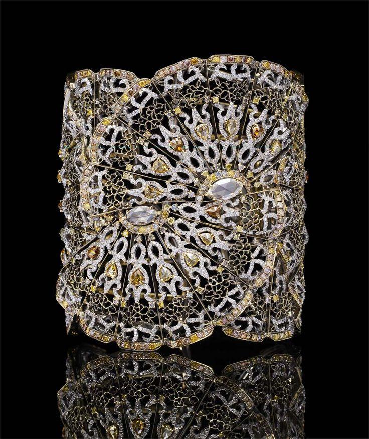Bao Bao Wan Fan bangle in yellow gold, set with yellow, cognac and pink diamonds, white diamonds and two marquise-shaped diamonds.