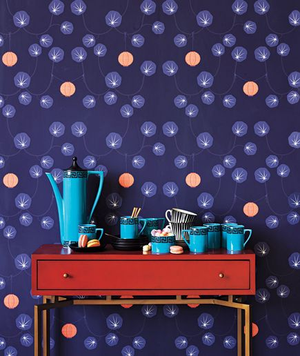 Purple wallpaper with a whimsical theme cheers up this space