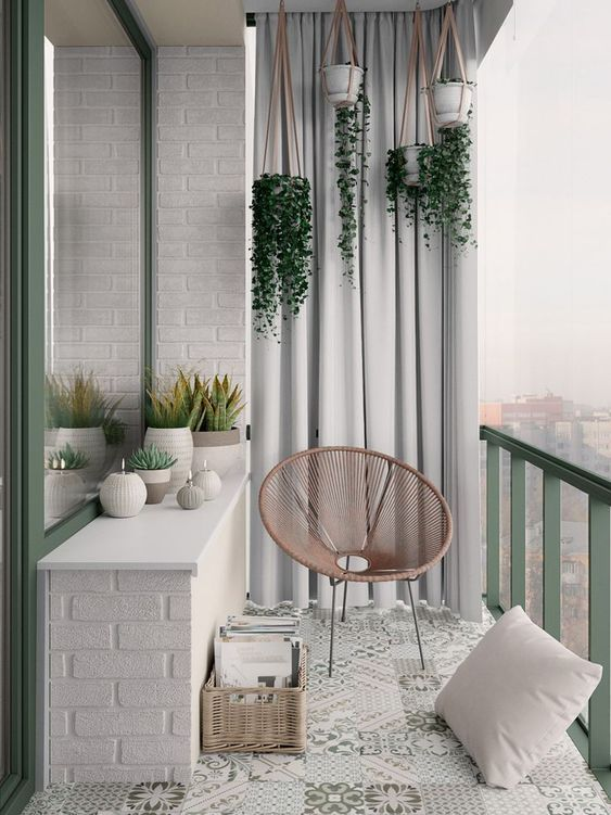 a Scandinavian balcony spruced up with touches of pastel green and pink, looks v…