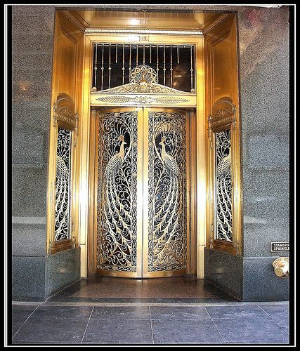 """This world renowned door, actually a piece of unusual real estate art, is one of three in creation called the """"Peacock Doors"""". While the design reflects the majestic and mystical bird, the door actually pays homage to the famed """"House of Peacock"""" - Chicago's historic and celebrated emporium of fine jewelry, fine china and imported gifts of silver and gold, founded by Elijah Peacock in 1837, Chicago's first incorporated business."""