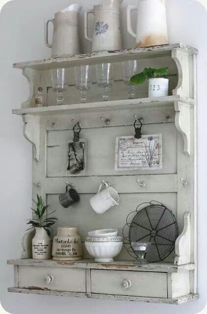Shelf made out of a old door. Must make one!