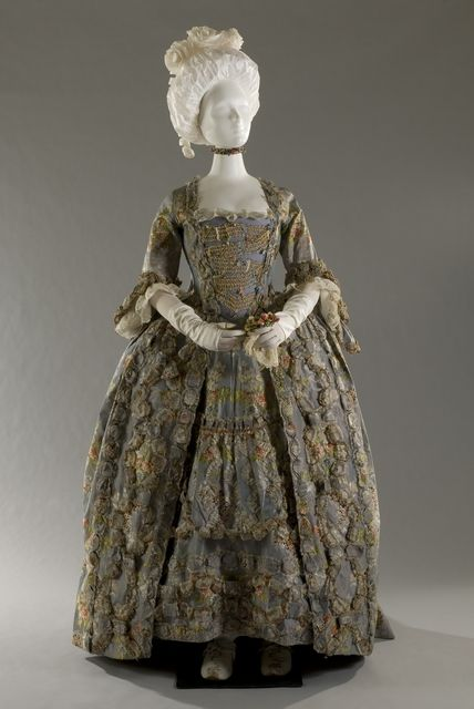 Women's ceremonial Dress, andrienne or robe à la française, circa 1755  Silk faille dress with pink textures polychrome motifs broccate floral lace and sinusoids