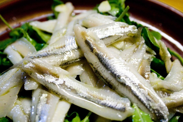 Boquerones en vinagre, vinegar-cured anchovies.  Can convert even anchovy haters!  Available in Spanish restaurants and gourmet markets in the US.
