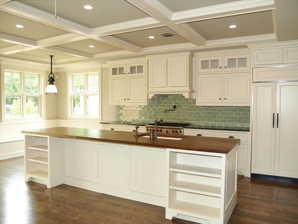 Like the idea of two bookcases/open storage on either end of the breakfast bar in our kitchen. Also, nice contrast of wood, white and glass tile!